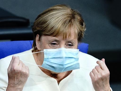 Tysklands statsminister Angela Merkel vil ha mer smittevern. Foto: Kay Nietfeld / dpa via AP / NTB