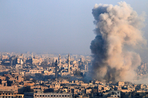 Smoke rises as seen from a rebel-held area of Aleppo