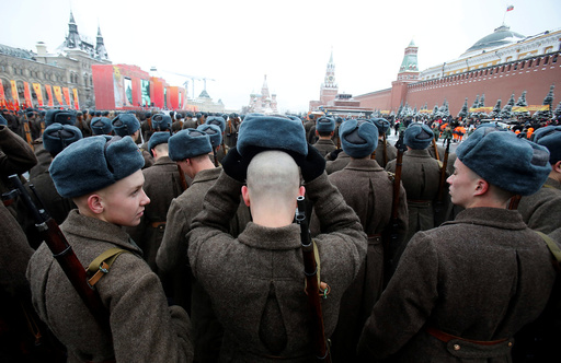 Servicemen dressed in historical uniforms wait before military parade marking anniversary of 1941 parade in Red Square in Moscow