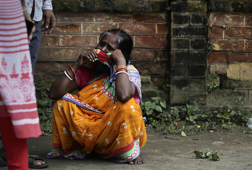 An Indian woman weeps after her son tested COVID-19 positive in Gauhati, India, Wednesday, July 8, 2020. India has overtaken Russia to become the third worst-affected nation by the coronavirus pandemic. (AP Photo/Anupam Nath)