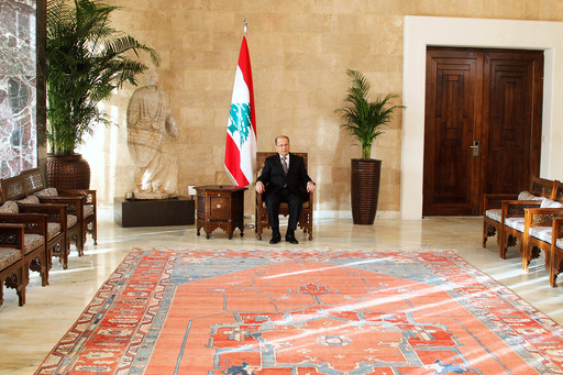 Aoun sits on the president's chair inside the presidential palace in Baabda