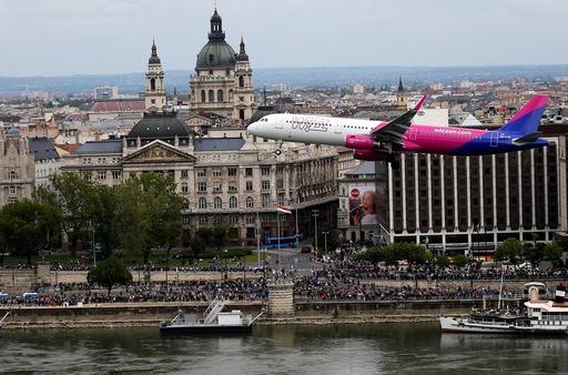 Wizz Air's Airbus A-321 flies along the Danibe river during an air show in Budapest
