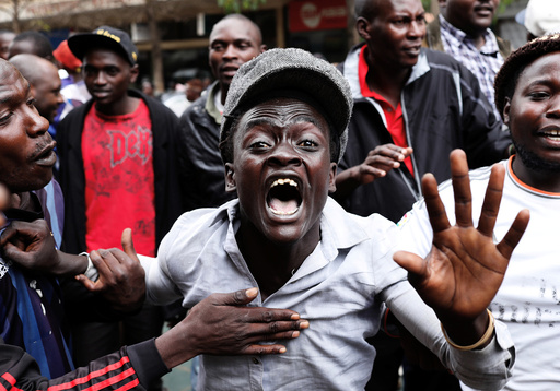 Supporters of Kenyan President Uhuru Kenyatta shout in front of Supreme Court in Nairobi