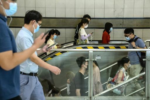Strenge tiltak håndheves i Beijing for å hindre ta deltavarianten av covid-19 People sprer seg. Foto: AP / NTB