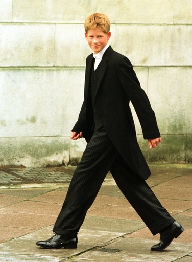 Prince Harry walks from his dormitory to begin his first day of lessons at England's elite school Et..