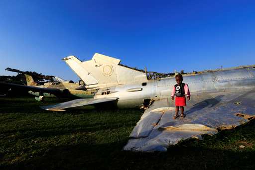 A child plays on the wreckages of war planes destroyed during an Israeli operation on the Entebbe international airport in 1976 to rescue hostages, at Aero beach, south of UgandaÕs capital Kampala