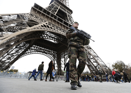 French military patrol near the Eiffel Tower the day after a series of deadly attacks in Paris