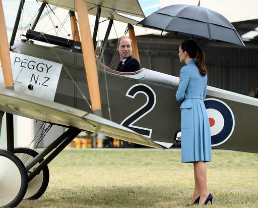Britain's Catherine, Duchess of Cambridge watches her husband Prince William sit in the cockpit of a Sopwith Pup at the Omaka Aviation Heritage Centre near Blenheim