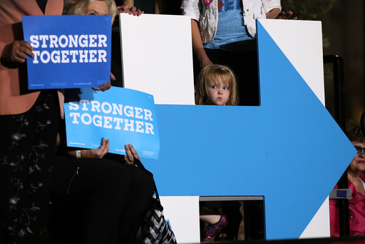 A girl listens to U.S. Democratic presidential nominee Hillary Clinton as she speaks at a rally in Las Vegas