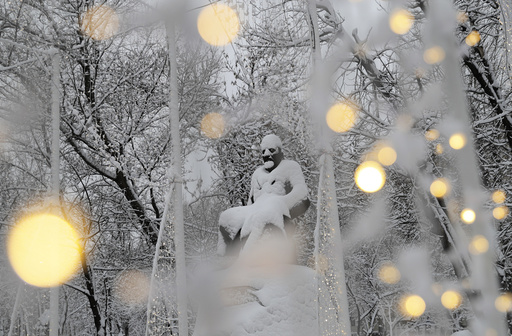 A view shows a monument to Kazakh poet Abai Kunanbayev after a heavy snowfall in Moscow