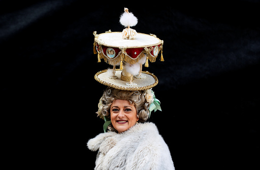 A reveller poses in Saint Mark's Square during the Venice Carnival, in Venice