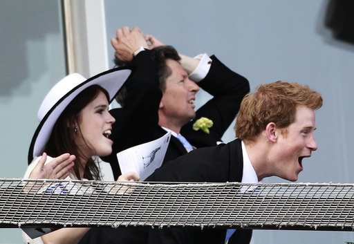 Britain's Princess Eugenie and and Prince Harry watch the Epsom Derby at Epsom Racecourse in southern England