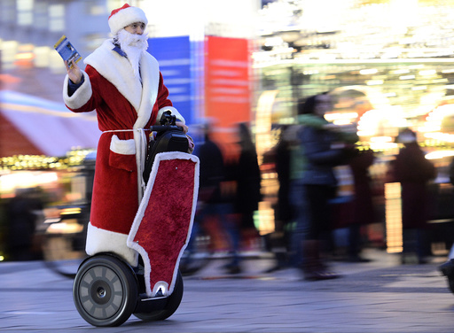 A man dressed as Santa Claus rides his Segway as he delivers gifts at the Christmas market in Hamburg