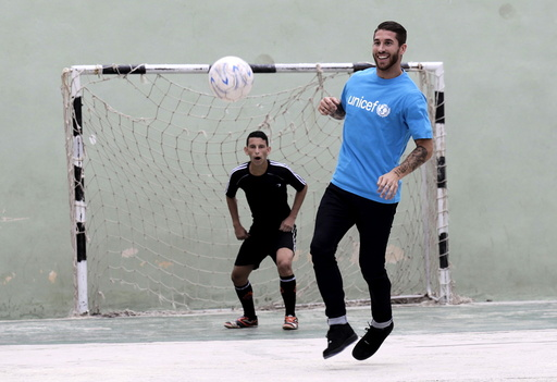 Spain's soccer player and UNICEF ambassador Sergio Ramos plays soccer with Cuban children in Havana