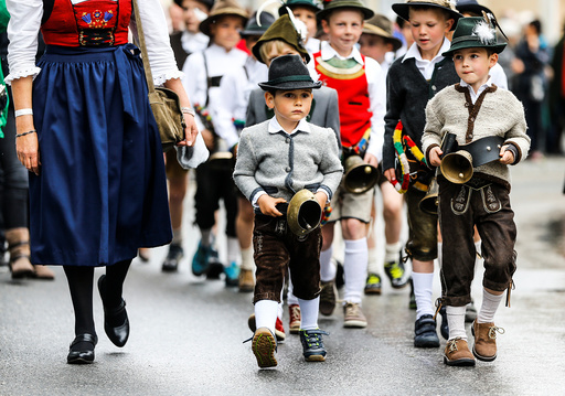 People in traditional Tyrolean clothes attend a parade at the annual Gauner Festival in Zell am Ziller
