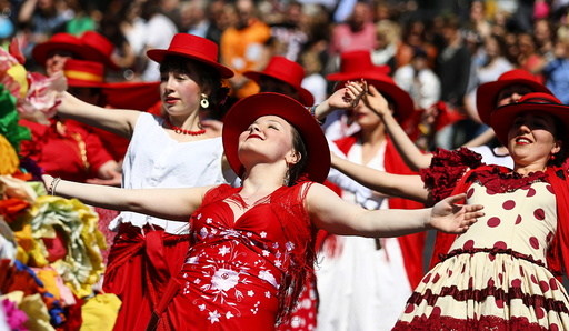 Dancers take part in the Karneval der Kulturen street parade of ethnic minorities, in Berlin