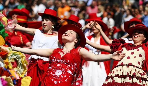 Dancers take part in the Karneval der Kulturen street parade of ethnic minorities, in Berlin