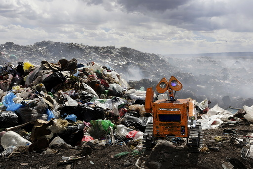 A replica of Wall-E character built by a Bolivian student Esteban Quispe is seen near a rubbish dump in Patacamaya, south of La Paz