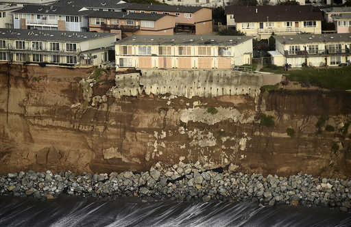 Uninhabitable apartments, in danger of collapsing into the Pacific Ocean, line Esplanade Ave. in Pacifica