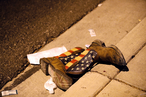 A pair of cowboy boots is shown in the street outside the concert venue after a mass shooting at a music festival on the Las Vegas Strip in Las Vegas