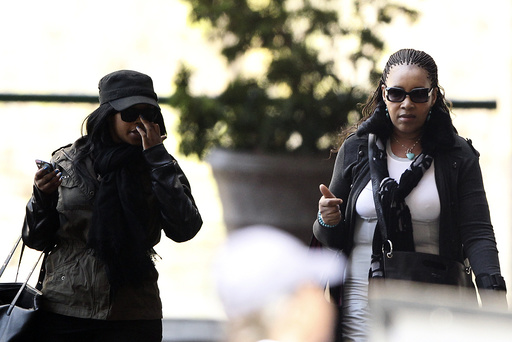 Zenani Mandela, daughter of former South African President Nelson Mandela, arrives with one of Mandela's granddaughters Zoleka Mandela at a Pretoria hospital where he is being treated