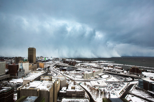 Storm clouds and snow blows off Lake Erie in Buffalo, New York