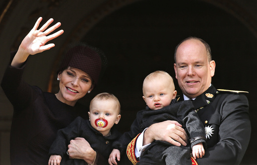 Prince Albert II of Monaco and his wife Princess Charlene hold their twins Prince Jacques and Princess Gabriella as they stand at the Palace Balcony during Monaco's National Day