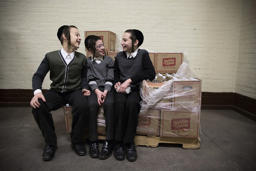 Children sit on a pile of boxes at a mass gathering of Satmar Hasidic Jews in New York