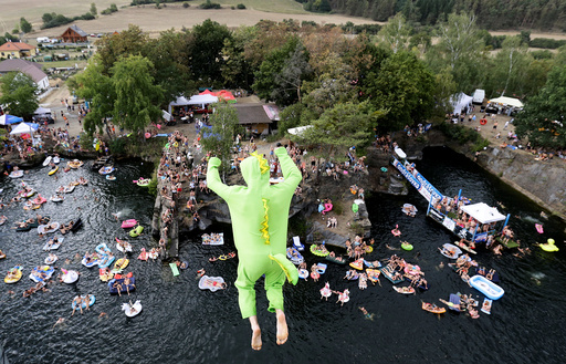 Competitor jumps into the water during a cliff diving competition near the central Bohemian village of Hrimezdice