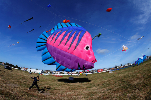 Kites of all shapes and sizes fill the air at the 22nd Cape Town International Kite Festival in Cape Town, South Africa