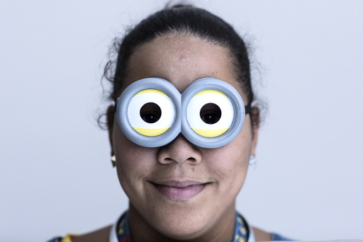 Michelle Carrera attends New York Comic Con dressed as a Minion in Manhattan