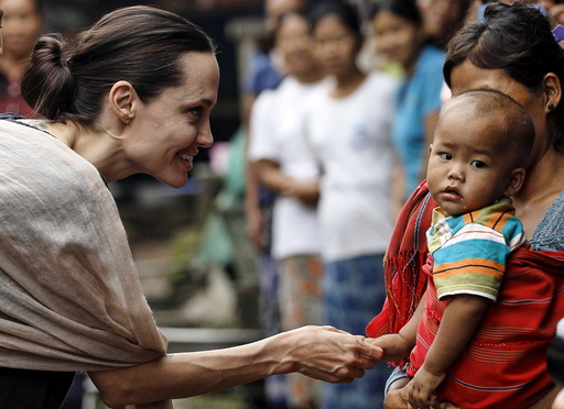 UNHCR special envoy Jolie Pitt shakes hand with Kachin ethnic refugee kid as she visits Jam Mai Kaung IDP camp in Myitkyina capital city of Kachin state