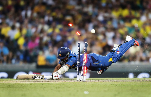 Sri Lanka's Jayawardene is run out during Cricket World Cup match against Australia in Sydney